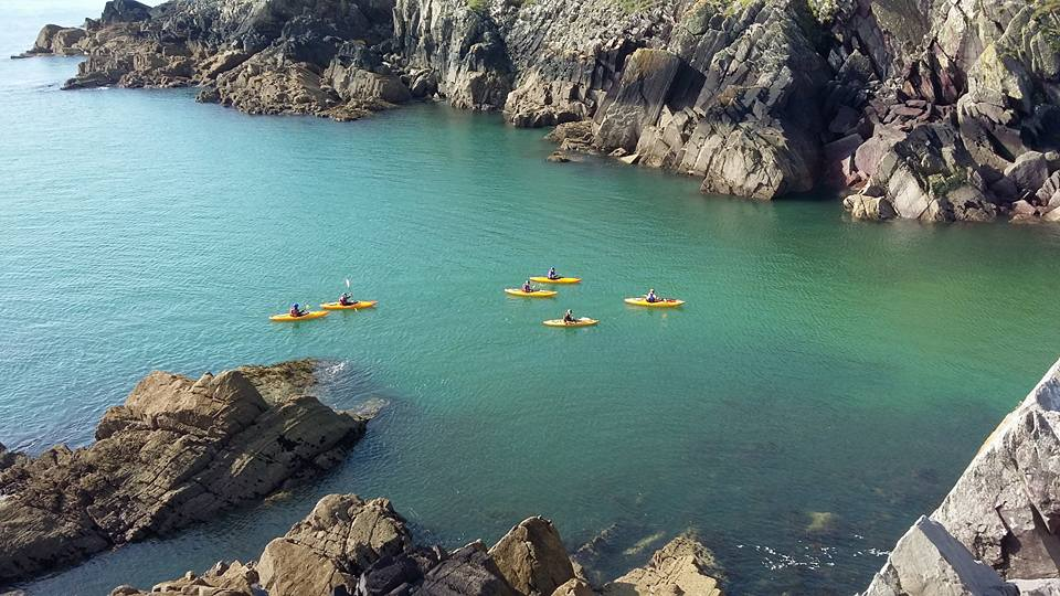 Kayakers from the top of Porth-Clais