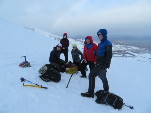 Jen consuming pasty in between ice axe arrest practice. Watched by Jenny, Nathan, Keith and Steve